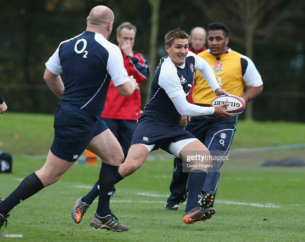 Toby Flood runs with the ball during the England training session held at St Georges Park on October 29, 2012 in Burton-upon-Trent, England.