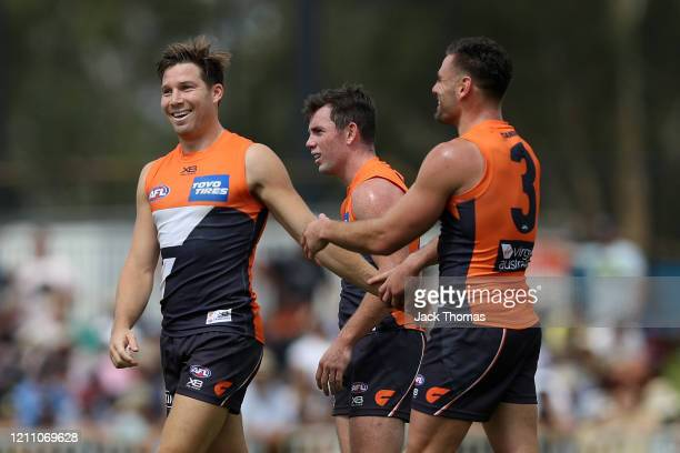 Toby Greene of GWS Giants celebrates with teammates after kicking a goal during the 2020 Marsh Community Series AFL match between the Greater Western...
