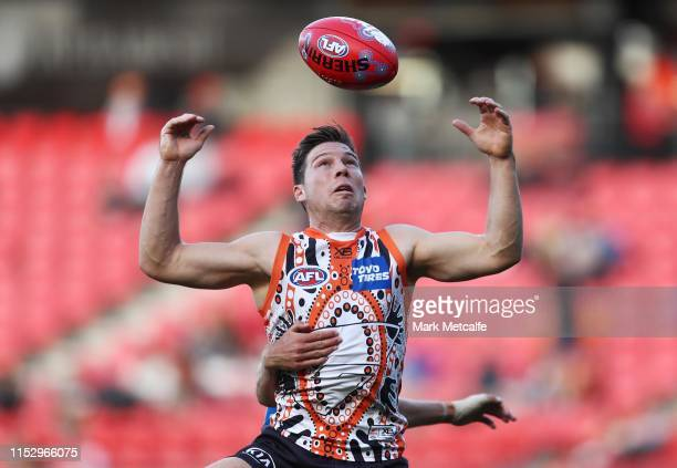 Toby Greene of the Giants and Jack Lukosius of the Suns compete for the ball during the round 11 AFL match between the Greater Western Sydney Giants...