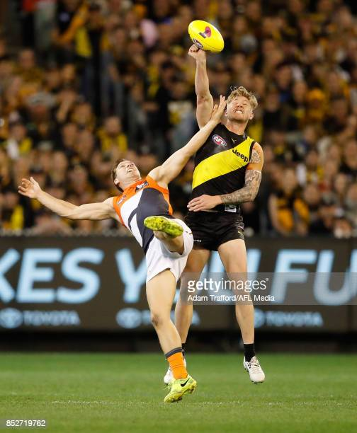 Toby Greene of the Giants and Nathan Broad of the Tigers compete for the ball during the 2017 AFL Second Preliminary Final match between the Richmond...
