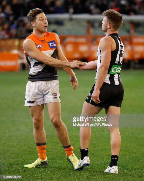 Toby Greene of the Giants and Taylor Adams of the Magpies exchange words after the 2018 AFL Second Semi Final match between the Collingwood Magpies...