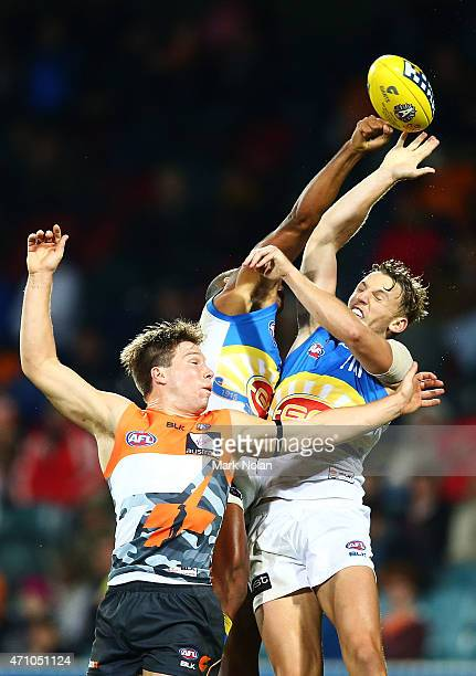 Toby Greene of the Giants and Trent McKenzie of the Suns contest possession during the round four AFL match between the Greater Western Sydney Giants...