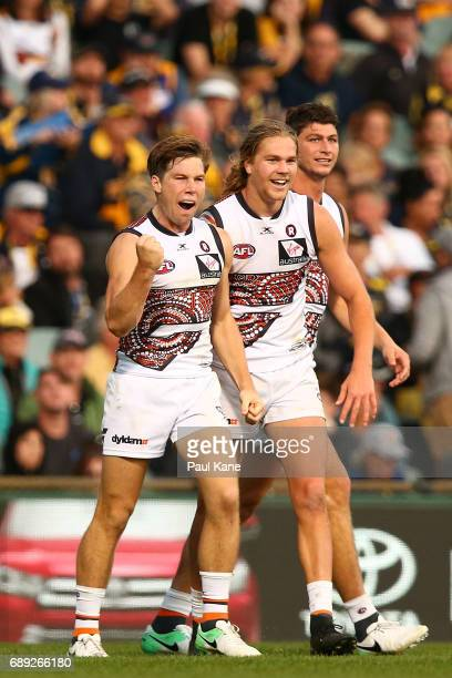 Toby Greene of the Giants celebrates a goal during the round 10 AFL match between the West Coast Eagles and the Greater Western Giants at Domain...