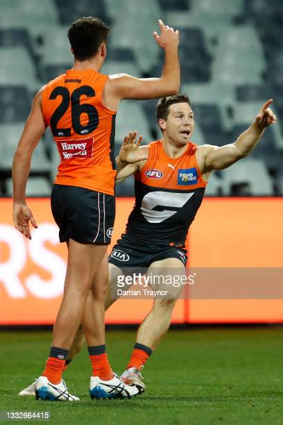 Toby Greene of the Giants celebrates a goal during the round 21 AFL match between Geelong Cats and Greater Western Sydney Giants at GMHBA Stadium on...