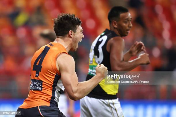 Toby Greene of the Giants celebrates kicking a goal during the round 8 AFL match between the Greater Western Sydney Giants and the Richmond Tigers at...