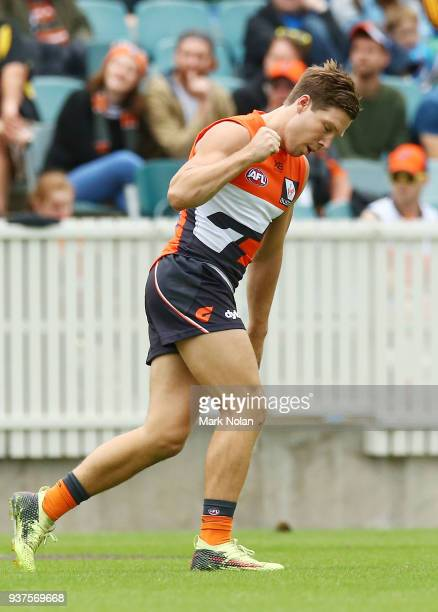 Toby Greene of the Giants celebrates kicking a goal during the round one AFL match between the Greater Western Sydney Giants and the Western Bulldogs...
