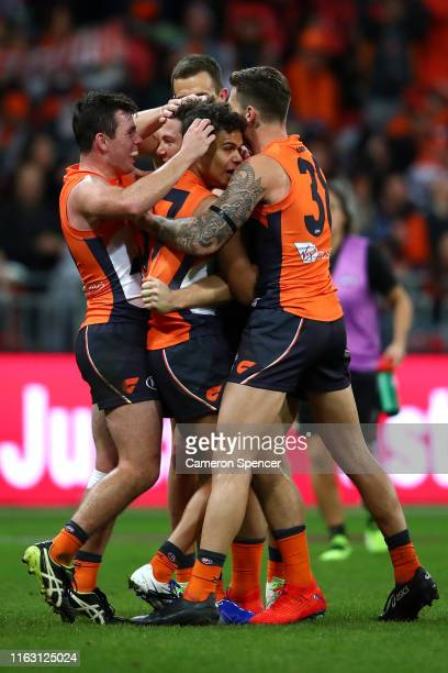 Toby Greene of the Giants celebrates kicking a goal with team mates during the Greater Western Sydney Giants and the Collingwood Magpies at GIANTS...
