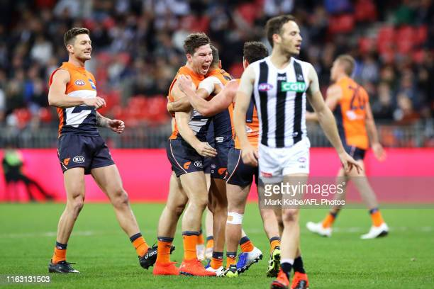 Toby Greene of the Giants celebrates with his team mates after kicking a goal during the Greater Western Sydney Giants and the Collingwood Magpies at...