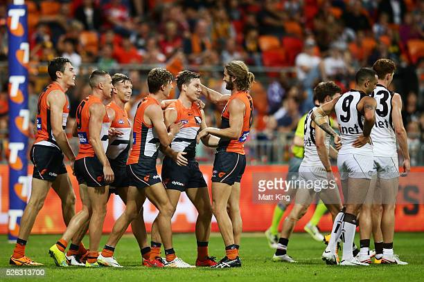 Toby Greene of the Giants celebrates with team mates after kicking a goal during the round six AFL match between the Greater Western Sydney Giants...