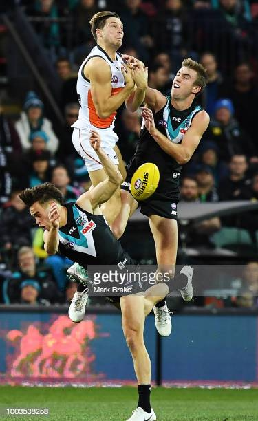 Toby Greene of the Giants flys high but cant make the mark over Karl Amon of Port Adelaide during the round 18 AFL match between the Port Adelaide...