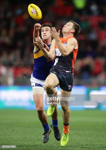 Toby Greene of the Giants is challenged by Elliot Yeo of the Eagles during the round 22 AFL match between the Greater Western Sydney Giants and the...