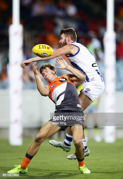 Toby Greene of the Giants is challenged by Lachlan Hansen of the Kangaroos during the JLT Community Series AFL match between the Greater Western...