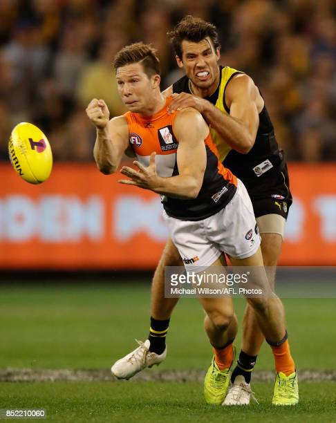 Toby Greene of the Giants is tackled by Alex Rance of the Tigers during the 2017 AFL Second Preliminary Final match between the Richmond Tigers and...