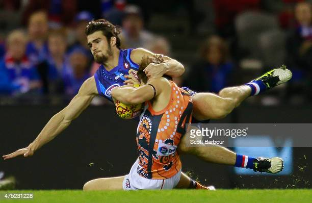 Toby Greene of the Giants is tackled by Easton Wood of the Bulldogs during the round nine AFL match between the Western Bulldogs and the Greater...