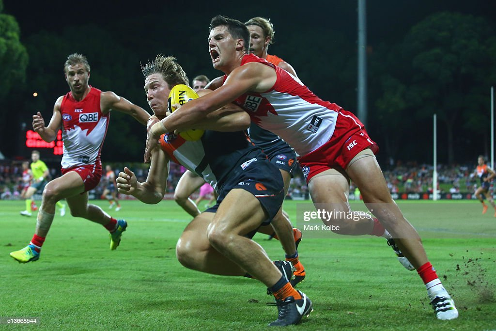 Toby Greene of the Giants is tackled by Nic Newman of the Swans during the 2016 AFL NAB Challenge match between the Sydney Swans and the Greater Western Sydney Giants at Drummoyne Oval on March 4, 2016 in Sydney, Australia.