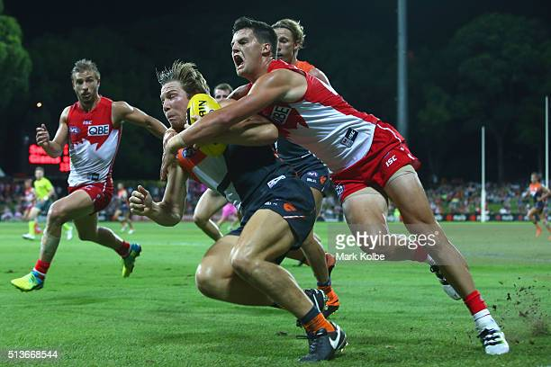 Toby Greene of the Giants is tackled by Nic Newman of the Swans during the 2016 AFL NAB Challenge match between the Sydney Swans and the Greater...