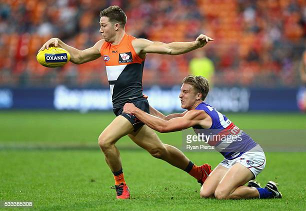 Toby Greene of the Giants is tackled by Shane Biggs of the Bulldogs during the round nine AFL match between the Greater Western Sydney Giants and the...