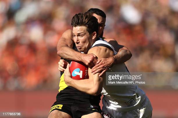 Toby Greene of the Giants is tackled by Shane Edwards of the Tigers during the 2019 AFL Grand Final match between the Richmond Tigers and the Greater...