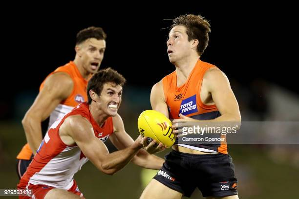 Toby Greene of the Giants is tackled during the JLT Community Series AFL match between the Sydney Swans and the Greater Western Sydney Giants at...