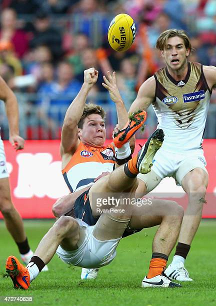 Toby Greene of the Giants is tackled during the round six AFL match between the Greater Western Giants and the Hawthorn Hawks at Spotless Stadium on...