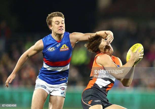 Toby Greene of the Giants is tackled high by Jack Macrae of the Bulldogs during the round six AFL match between the Greater Western Sydney Giants and...
