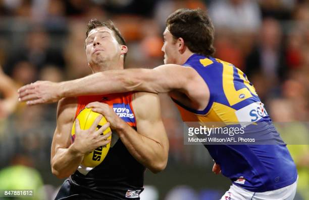 Toby Greene of the Giants is taken high by Jeremy McGovern of the Eagles during the 2017 AFL First Semi Final match between the GWS Giants and the...