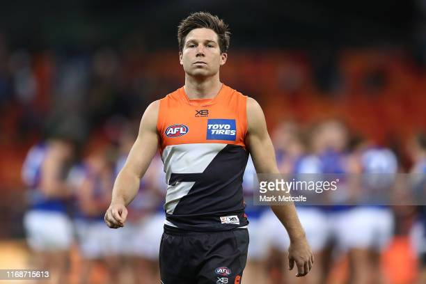 Toby Greene of the Giants looks dejected as he walks from the field after defeat in the round 22 AFL match between the Greater Western Sydney Giants...