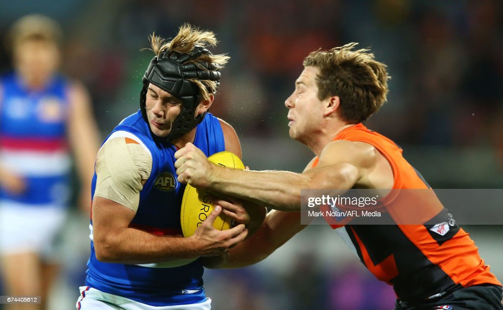 Toby Greene of the Giants makes a late hit on Caleb Daniel of the Bulldogs during the round six AFL match between the Greater Western Sydney Giants and the Western Bulldogs at UNSW Canberra Oval on April 28, 2017 in Canberra, Australia.