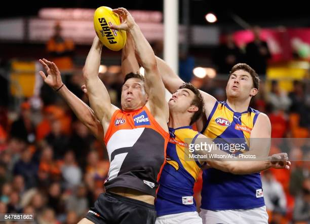Toby Greene of the Giants marks the ball ahead of Elliot Yeo and Jeremy McGovern of the Eagles during the 2017 AFL First Semi Final match between the...
