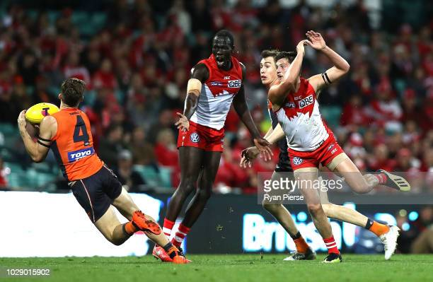 Toby Greene of the Giants puts his foot out while marking during the AFL Second Elimination Final match between the Sydney Swans and the GWS Giants...