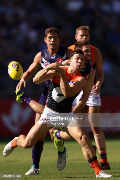 Toby Greene of the Giants spills a mark against Reece Conca of the Dockers during the round 2 AFL match between the Fremantle Dockers and the GWS...