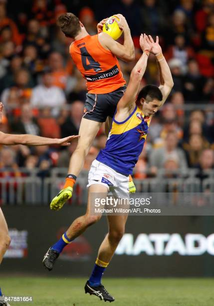 Toby Greene of the Giants takes a high mark over Tom Barrass of the Eagles during the 2017 AFL First Semi Final match between the GWS Giants and the...