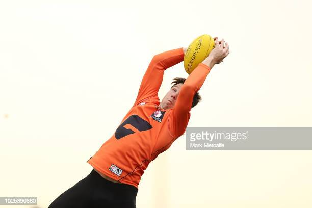 Toby Greene of the Giants takes a mark during a Greater Western Sydney Giants AFL training session at the WestConnex Centre on August 31, 2018 in...