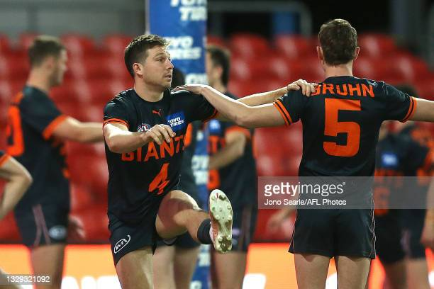 Toby Greene of the Giants warms up before the round 18 AFL match between Greater Western Sydney Giants and Sydney Swans at Metricon Stadium on July...