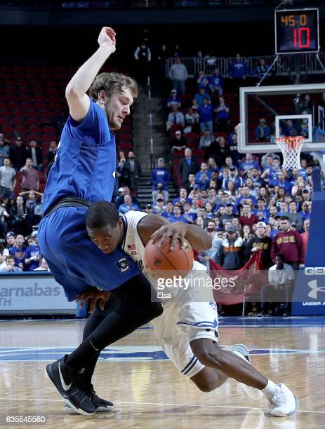 Toby Hegner of the Creighton Bluejays tries to stop Khadeen Carrington of the Seton Hall Pirates as he drives by in the second half on February 15...