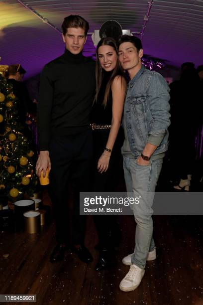 Toby HuntingtonWhiteley Amber Le Bon and Sam Way attend Bumble's Christmas party at Omeara London on December 18 2019 in London England
