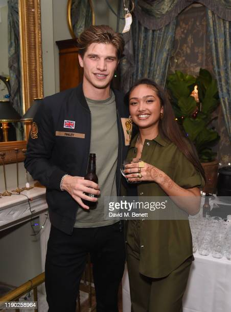 Toby HuntingtonWhiteley and Joy Crookes attend Mulberry's 'My Local' Festive Event on November 26 2019 in London England
