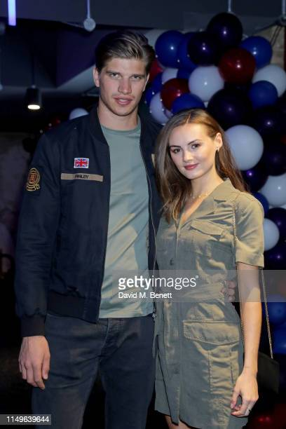 Toby HuntingtonWhiteley and Niomi Smart attend KOBOX New Flagship studio launch party on King's Road on May 16 2019 in London England