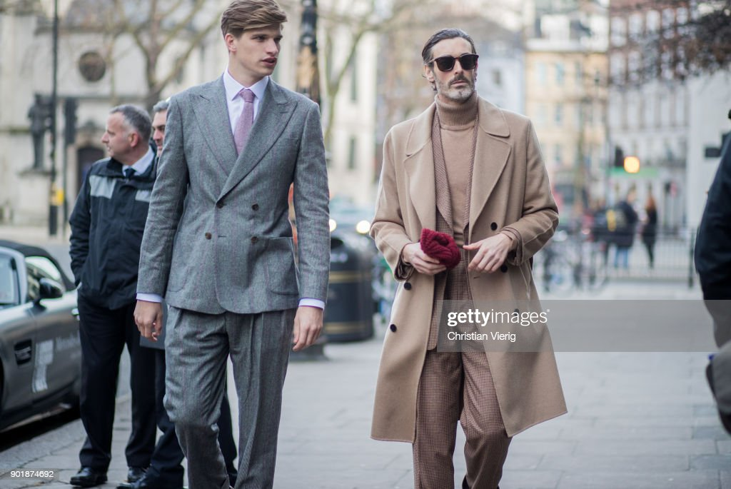 Toby Huntington-Whiteley and Richard Biedul wearing beige wool coat, suit, sunglasses during London Fashion Week Men's January 2018 on January 6, 2018 in London, England.