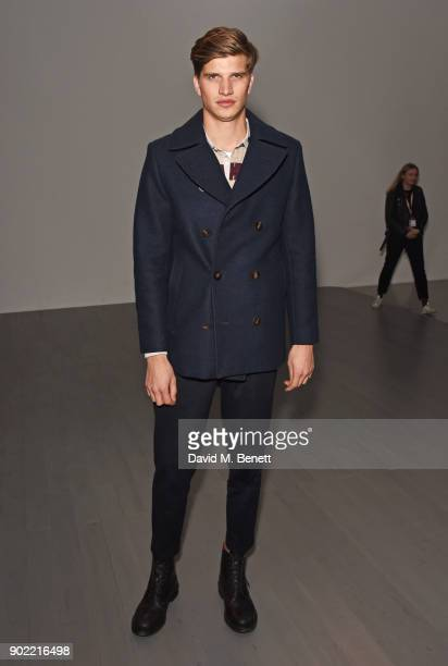 Toby HuntingtonWhiteley attends the Christopher Raeburn show during London Fashion Week Men's January 2018 at BFC Show Space on January 7 2018 in...