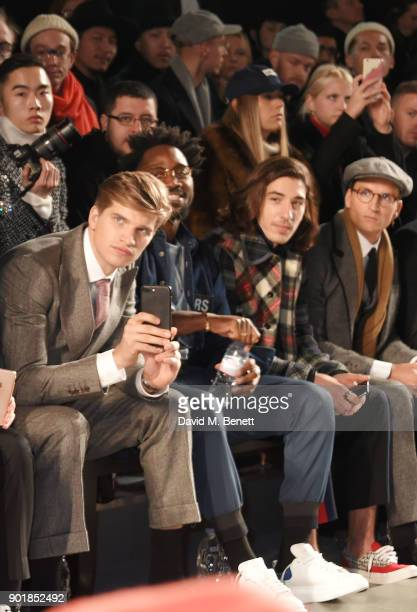 Toby HuntingtonWhiteley Jesiah Sampson Hector Bellerin and Ollie Proudlock sit in the front row at the Oliver Spencer LFWM AW18 Catwalk Show at the...