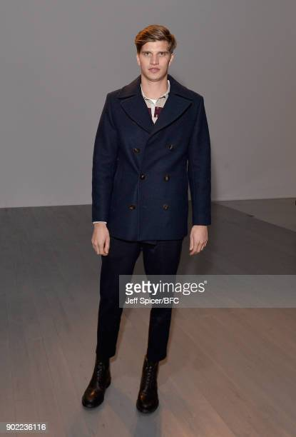 Toby HuntingtonWhiteley poses on the front row at the Christopher Raeburn show during London Fashion Week Men's January 2018 at BFC Show Space on...