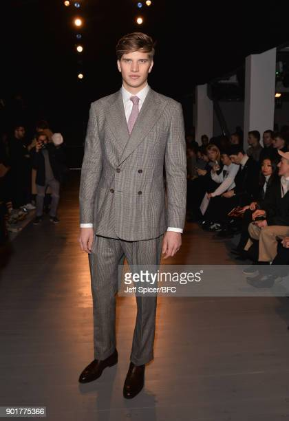 Toby Huntington-Whiteley poses on the front row at the John Lawrence Sullivan show during London Fashion Week Men's January 2018 at BFC Show Space on...