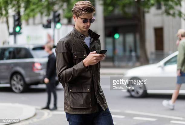 Toby HuntingtonWhiteley wearing an olive jacket during the London Fashion Week Men's June 2017 collections on June 12 2017 in London England