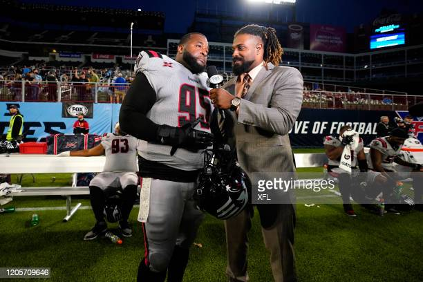 Toby Johnson Jr #95 of the New York Guardians is interviewed by Cameron Jordan of the New Orleans Saints during the XFL game against the Dallas...