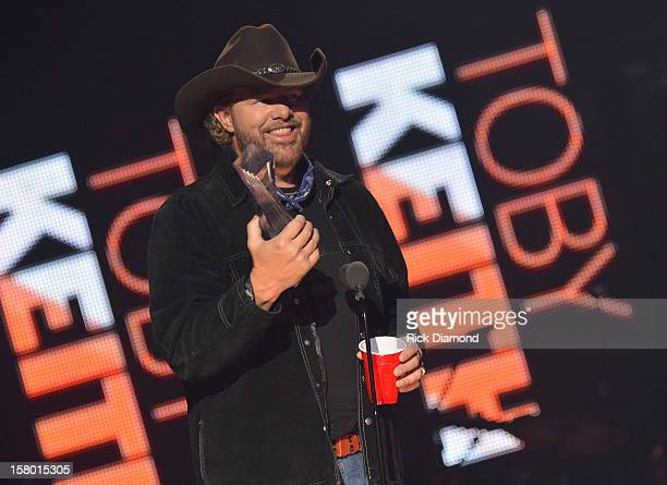 Toby Keith accepts award onstage during the 2012 CMT Artists Of The Year at The Factory at Franklin on December 3 2012 in Franklin Tennessee