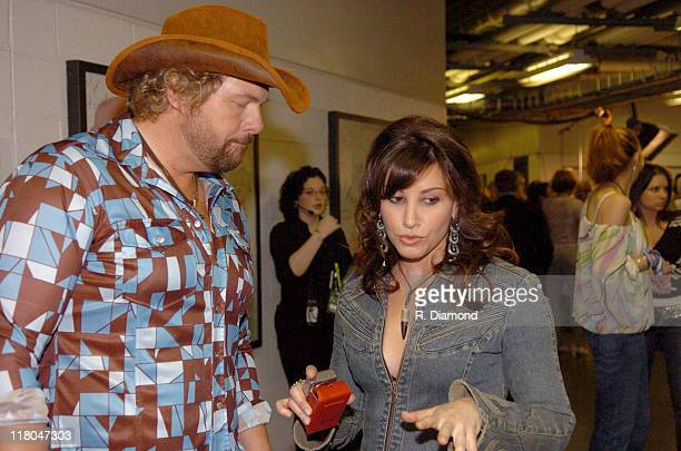 Toby Keith and Gina Gershon during 2005 CMT Music Awards Backstage at Gaylord Entertainment Center in Nashville Tennessee United States