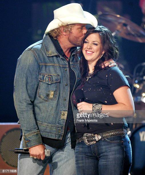Toby Keith and his daughter Krystal perform on stage at the 38th Annual CMA Awards at the Grand Ole Opry House November 9 2004 in Nashville Tennessee