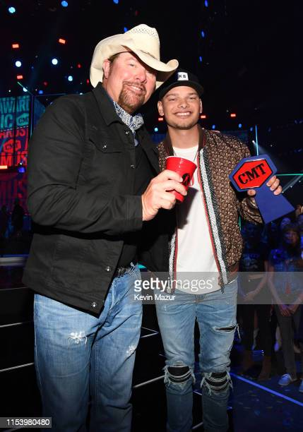 Toby Keith and Kane Brown attend the 2019 CMT Music Awards Backstage Audience at Bridgestone Arena on June 05 2019 in Nashville Tennessee