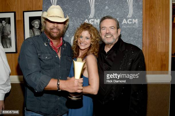 Toby Keith Laura Savini and Jimmy Webb attend the 11th Annual ACM Honors at the Ryman Auditorium on August 23 2017 in Nashville Tennessee